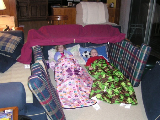 Katie and Luke sleeping in their fort
