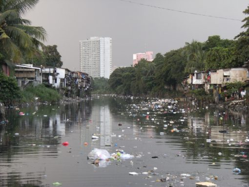 A river full of trash and human feces